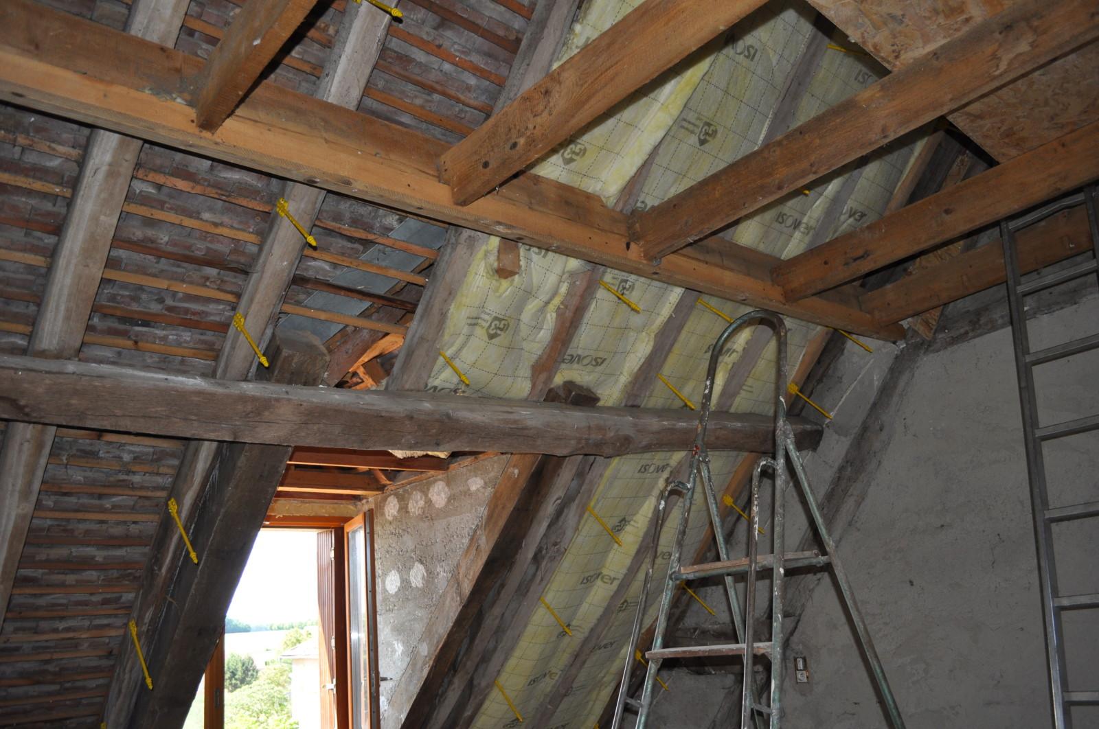 Pose laine de verre sous toiture - Combles isolation